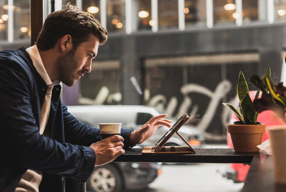 Usa, New York City, Businessman Sitting In Coffee Shop, Using Digital Tablet