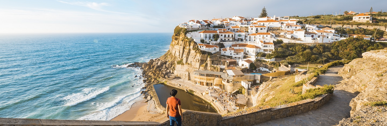 Tourist Admiring The View In Azenhas Do Mar, Lisbon